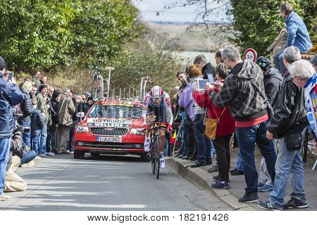 Conflans-Sainte-HonorineFrance-March 62016: The Belgian cyclist Tim Wellens of Lotto-Soudal Team riding during the prologue stage of Paris-Nice 2016.