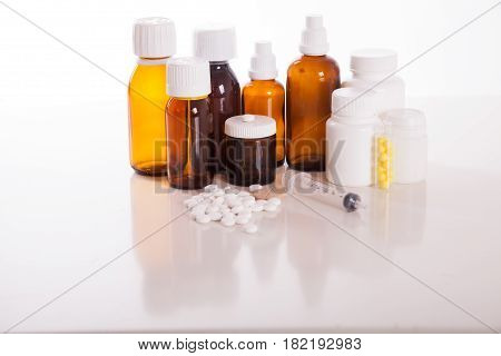 Composition of medicine bottles and pills isolated on white.