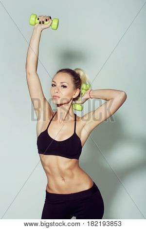 Pretty Sporty Girl Athlete Holding Dumbbell Or Weight Kettlebell