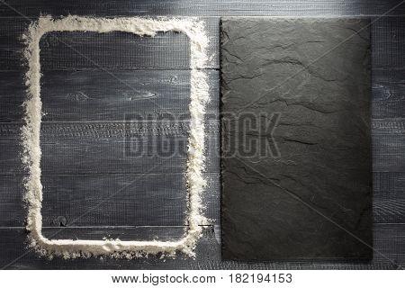 flour powder on wooden background