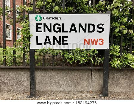 LONDON - APRIL 14, 2017: Street sign on Englands Lane between Swiss Cottage, Chalk Farm and Belsize Park in the Borough of Camden, North London, UK.