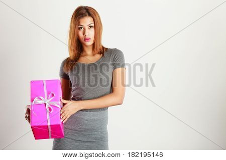 Beautiful Woman With Pink Gift.