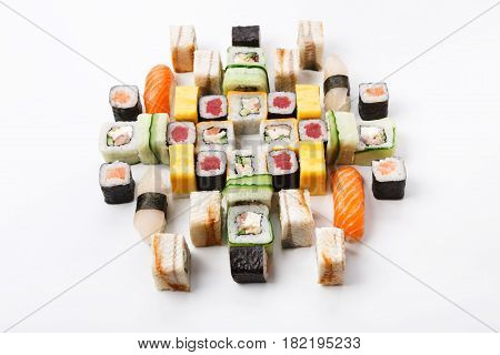 Japanese food restaurant delivery - sushi maki, unagi, tuna and california roll big party platter set isolated on white background, above view