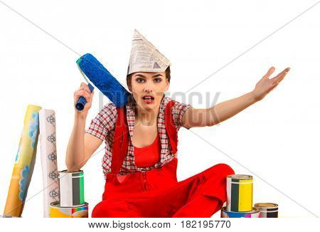 Repair home woman holding paint roller for wallpaper. Aggressive screaming girl in newspaper cap renovation apartment. Paint bank and roll paper background on isolated.