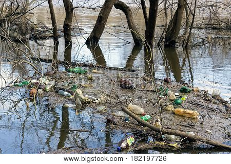 The river Klyazma which has spilled on spring collects tons of garbage from coast