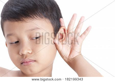 Closeup portrait child hearing something hand to ear gesture isolated on white background.