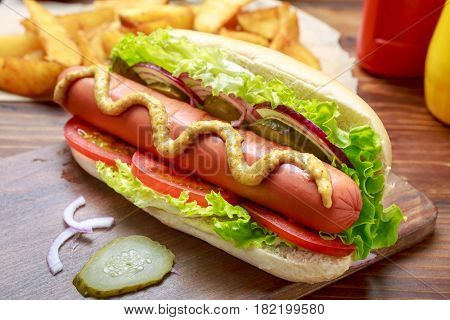 Delicious Healthy Hot Dog with vegetables and mustard on a cutting board close-up
