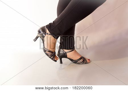 Woman dancing with black salsa sandals. White background