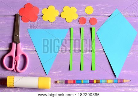 Making paper crafts for mother's day or birthday. Step. Cut details, scissors, glue stick, flowers templates, pencil on a table. Set for children's art activity at home or in kindergarten. Top view