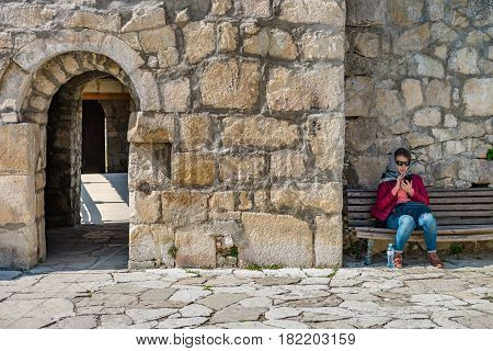 Georgia, Kutaisi - April 01, 2017: People in Motsameta monastery. The Tsar Bagrat III reconstructed the church in the 10 th century. The building was reconstructed again in the 19 th century.