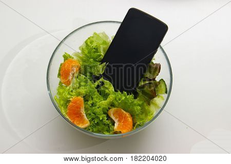 Smartphone In The Salad. Symbol Of Dependence On Social Networks, Putting Pictures Of Food In Social