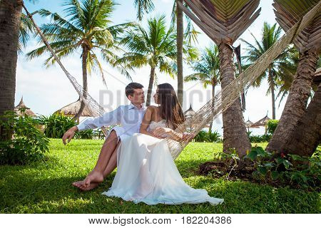Newly married couple after wedding in luxury resort. Romantic bride and groom. Tropical country.