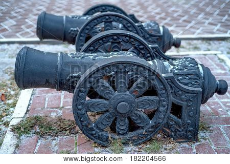 Old decorative vintage metal canon on a gun carriage