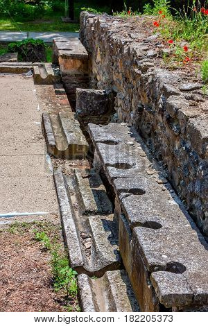Ancient public toilets along the central road in Dion archaeological park, Pieria, Greece.
