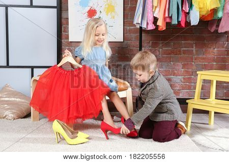 Cute little children playing in dressing room