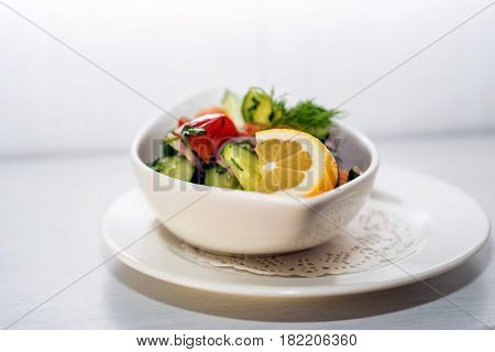 Fresh rustic salad made of various vegetables in bowl at restaurant