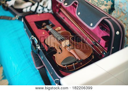 Violin Suitcase Lying On Couch In Music Classroom.