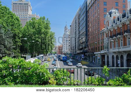 Spain. Sunny day, Madrid and cars and bus
