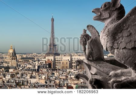 Eiffel Tower and Chimeras looking on Paris, France