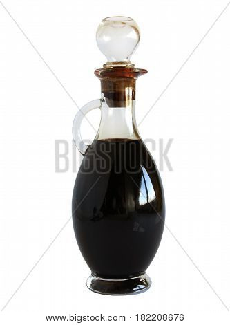 Glass bottle with balsamic vinegar isolated on white background