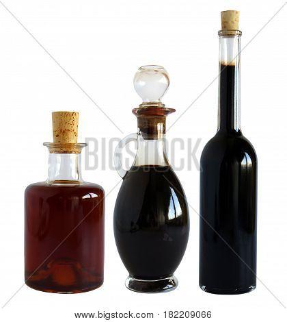 Glass bottles with balsamic vinegar isolated on white background