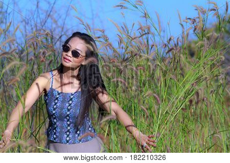 Woman show body outdoor in field flower gass at Mukdahan Nation Park Thailand
