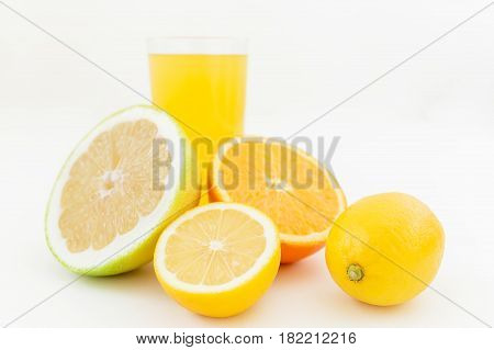 Natural juice of lemon, orange, mandarin, and sweetie on white background. Flat lay, top view. Fruit background