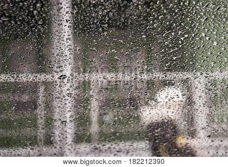 windshield rain drop splash, Windshield drops of rain splash, view of the street from the car