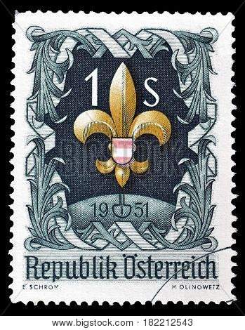 AUSTRIA - CIRCA 1951 : Cancelled postage stamp printed by Austria, that shows Badge of the Austrian Scouting over globe.