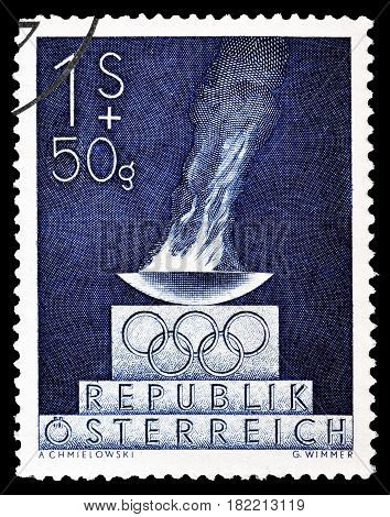 AUSTRIA - CIRCA 1948 : Cancelled postage stamp printed by Austria, that shows Olympic flame.