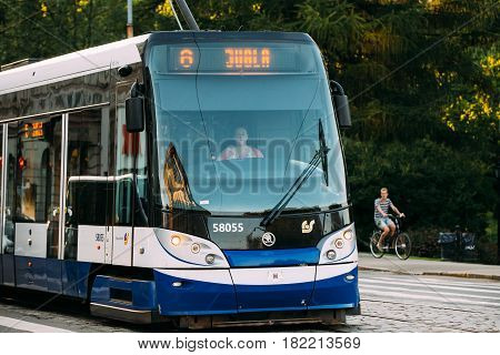 Riga, Latvia - July 2, 2016: Public modern tram with the number of the sixth route on summer street Siegfried Anna Meierovics Boulevard in Riga, Latvia