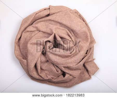 Light brown linen and cashmere scarf on white background scarf top view .