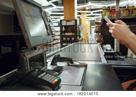Cropped image of cashier's desk in supermarket shop