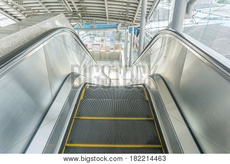 Escalators at BTS in Bangkok Thailand .