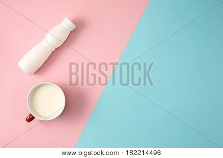 The bottle of yogurt with cup. Concept of diet and healthy lifestile