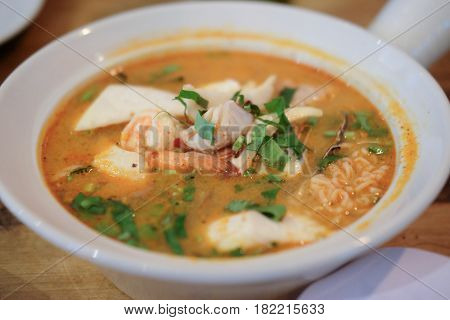 Tom yam kong or Tom yum Tom yam is a spicy clear soup typical in Thailand