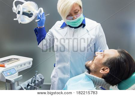 Dental doctor with patient. Stomatologist at workplace. How to become a dentist.