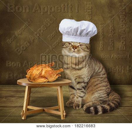 The cat cook made a fried chicken. It is on the table. He wears a chef hat.