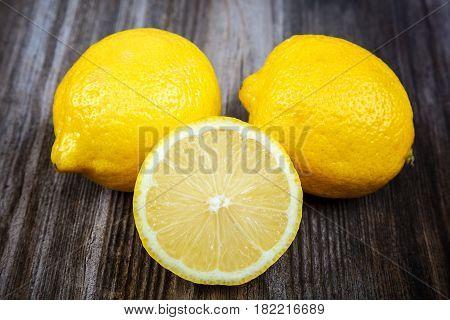 Fresh lemons on a wooden background. the fruit
