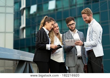 Successful usiness people and coworkers meeting outside