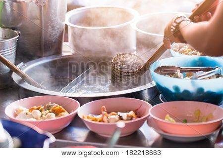 Chinese noodle ripen with spoon dumpling in hot boiled soup in Thailand street food