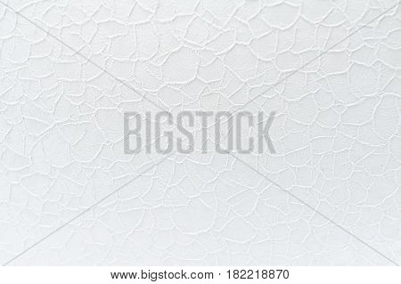 White lace guipure cloth background with floral pattern. Selective focus