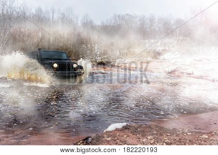 Leningrad region, Russia - April 16, 2017. Jeep Wrangler rides on the river. Wrangler is a compact SUV produced by Chrysler