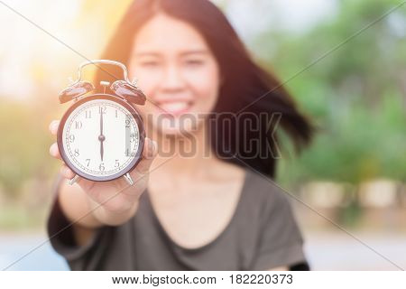 Asian Women Hand Show Clock Times At 6 O'clock, It's Time To Do Something Concept.