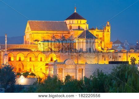 Illuminated Great Mosque Mezquita - Catedral de Cordoba during evening blue hour, Cordoba, Andalusia, Spain