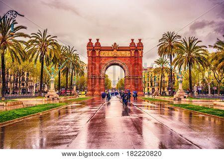 The Arc de Triomf, Arco de Triunfo in Spanish, a triumphal arc in the city of Barcelona, in Catalonia, Spainin the rain