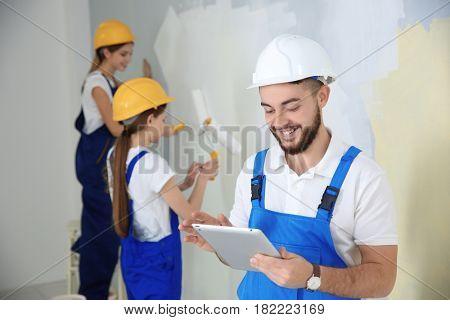Young decorators renewing apartment
