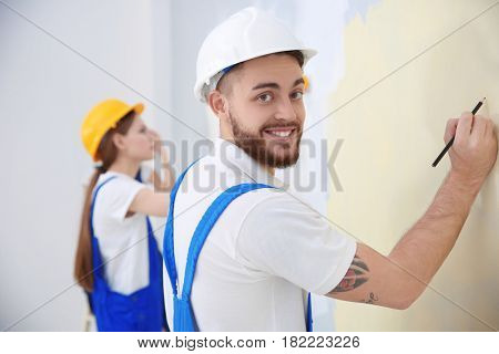 Young decorator renewing apartment