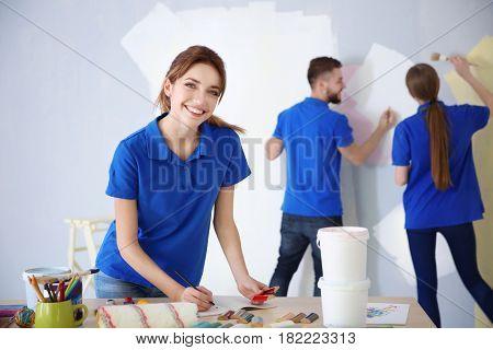 Young decorator in room prepared for repair