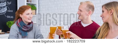 Friends Toasting On A Meeting
